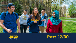 Photo of a diverse group of students walking and smiling in the University of Michigan Law quad including a lower-third with the words