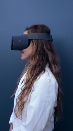 Dr. Jadranka Stojanovska, one of the collaborators on the virtual MRI, tries on the device