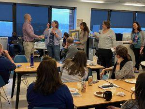 Academic Innovation staff raffling off items for United Way raffle