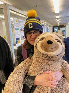 Jen Vetter with stuffed animal sloth