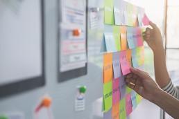 designer workshopping an idea on a board
