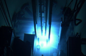(Illustration of a nuclear reactor, glowing blue.)