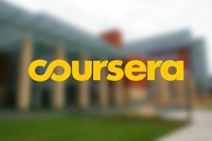 coursera logo overlaid on blurred image of Michigan campus