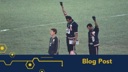 Peter Norman, John Carlos and Tommie Smith on the Olympic podium at the 1968 Olympic games. Carlos and Smith are raising black-gloved fists in the air