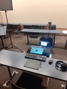 laptops and camera are set up in makeshift production studio