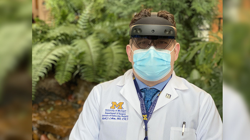 Doctor standing with Hololens2 headset and facemask
