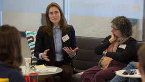 Stephanie Rosen speaking while sitting down and Jane Berliss-Vincent listening while seated