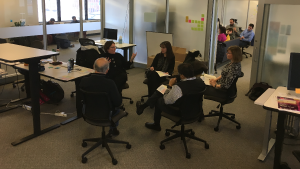 Two groups of faculty and staff sitting in circles