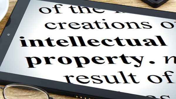 """Photo of a tablet with the words """"intellectual property"""" on the screen"""