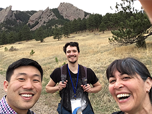 Selfie photo of James Park, Michael Skib and Noni Korf in front of a mountain