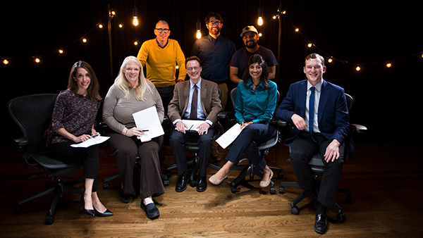 The Sleep Teach-Out instructional team, including learning experience designers, program managers and media production specialists in a filming studio surrounded by lightbulbs