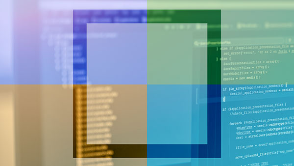 A blurred image of code on a monitor with a overlay of different colors in four quadrants