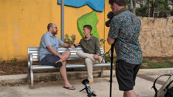 Will Potter interviewing on a bench