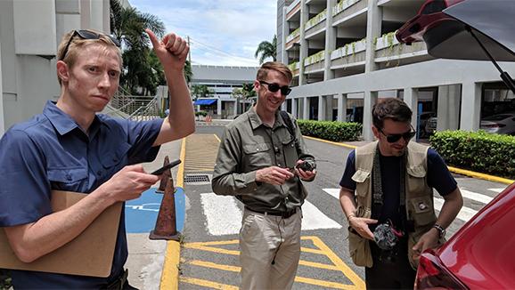 Benjamin Morse, Will Potter, and Sean Patrick packing up a car